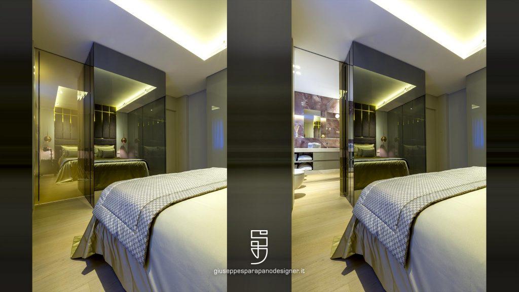 camera da letto con bagno in camera a vista e porte a scomparsa vetro-specchio e led Viabizzuno