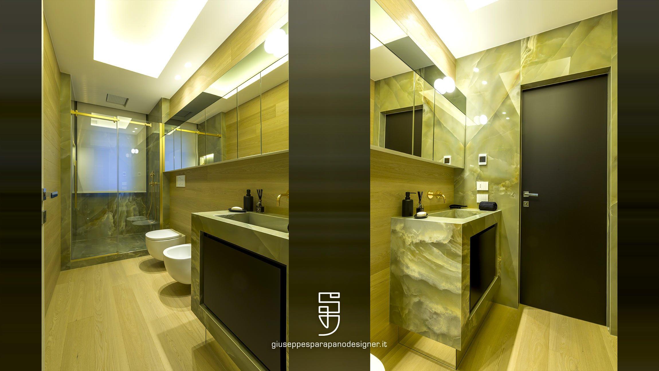 bagno con box doccia e lavandino in kerlite onice verde e sanitari sospesi illuminato a led by Vizzuno e parquet in rovere